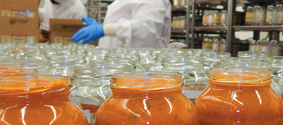 Food jars on production line